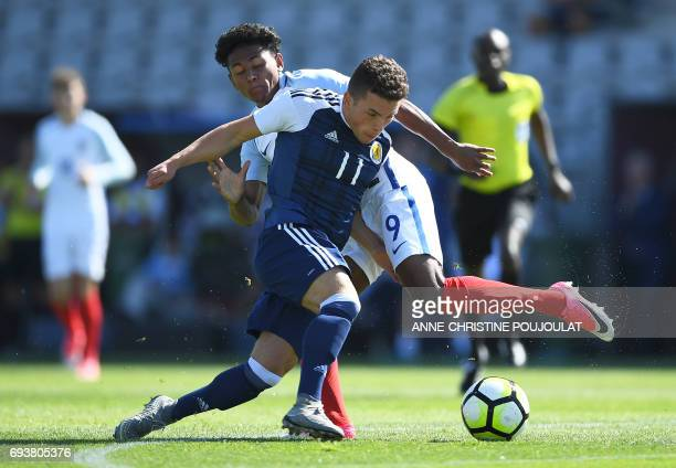 Scotland's Adam Frizzell vies with England's Demetri Mitchell during the Under 21 international football semi final match Scotland vs England at the...