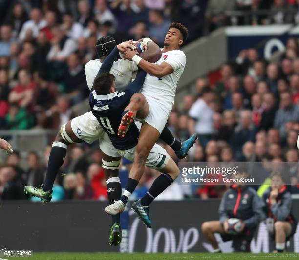 Scotland's Ali Price competes for a high ball against England's Maro Itoje and Anthony Watson during the RBS Six Nations Championship match between...
