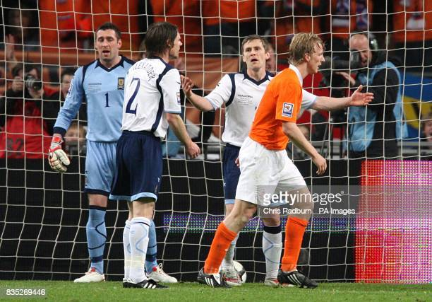 Scotland's Allan McGregor Gary Naysmith and Graham Alexander stand dejected after Holland's Robin Van Persie scores his sides second goal of the game