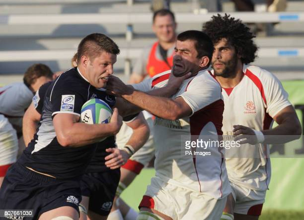 Scotland's Allister Hogg runs at the Georgian defence during the IRB Nations Cup at Stadional Arcul de Triumf Bucharest