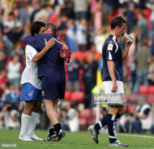 Scotland's Ally McCoist hugs Italy's Gennaro Gattuso at the end as Barry Ferguson walks off during the World Cup qualifier at Hampden Park Glasgow...