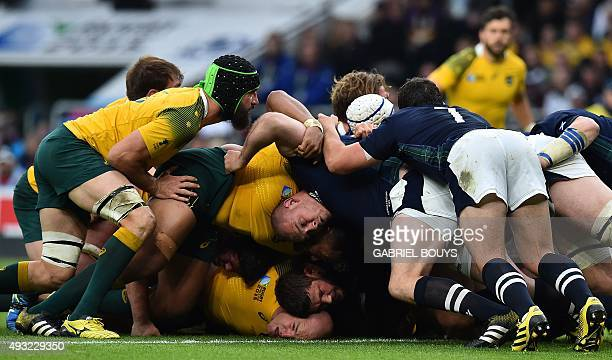 Scotland's and Australia's players vie in a scrum during a quarter final match of the 2015 Rugby World Cup between Australia and Scotland at...