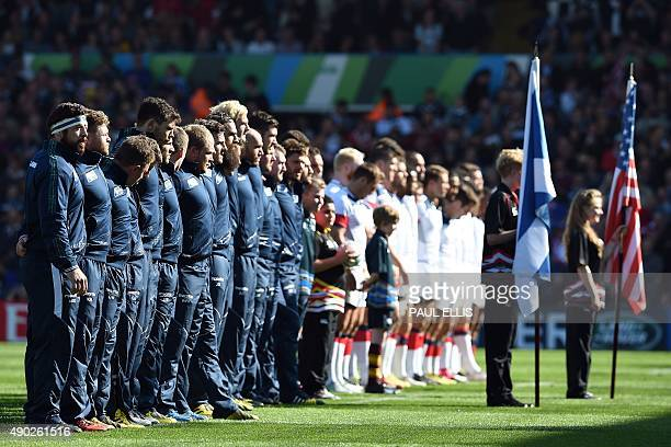 Scotland's and USA's players line up prior to a Pool B match of the 2015 Rugby World Cup between Scotland and USA at Elland Road in Leeds north...