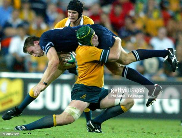 Scotland's Andrew Henderson is lifted of his feet as he is tackled by Australia's David Lyons during their Rugby World Cup first quarterfinal match...