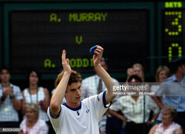 Scotland's Andy Murray celebrates his win against USA's Andy Roddick during the third round of The All England Lawn Tennis Championships at Wimbledon