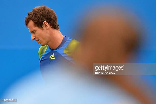 Scotland's Andy Murray reacts following a point against France's Nicolas Mahut during their ATP Aegon Championships tennis match at the Queen's Club...