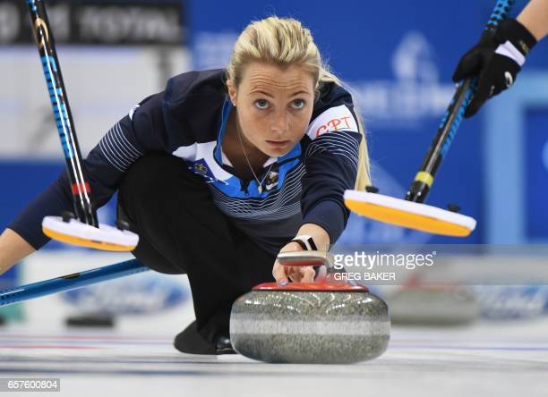 Scotland's Anna Sloan releases the stone during their playoff against Sweden at the Women's Curling World Championships in Beijing on March 25 2017 /...