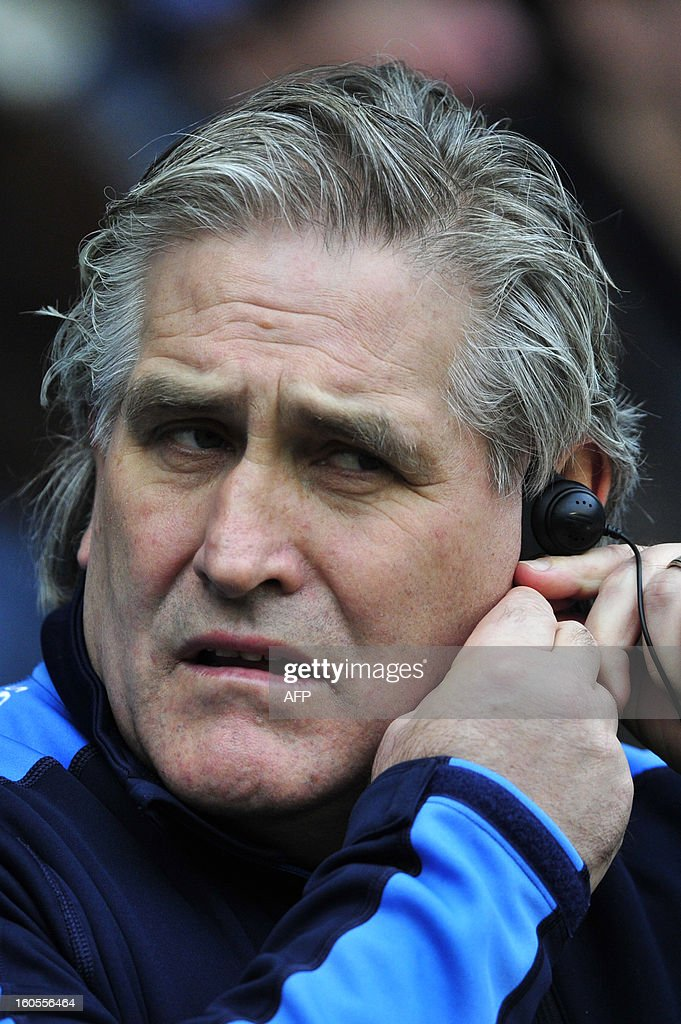 Scotland's Australian interim coach Scott Johnson fixes his ear-piece before the 6 Nations international rugby union match between England and Scotland at Twickenham Stadium, southwest of London on February 2, 2013.