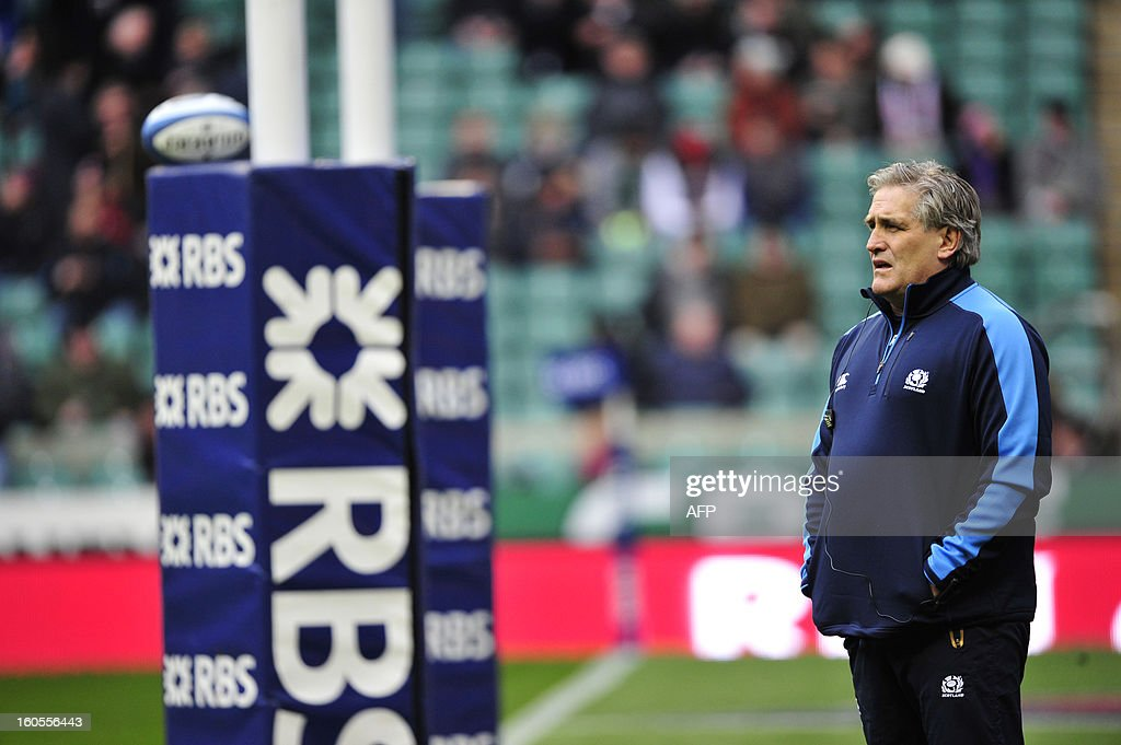 Scotland's Australian interim coach Scott Johnson watches his team warm up before the 6 Nations international rugby union match between England and Scotland at Twickenham Stadium, southwest of London on February 2, 2013.