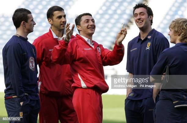 Scotland's Barry Ferguson Allan McGregor and Chris Burke chat with Georgia's Shota Arveladze and Zurab Khizanishvili during the UEFA European...