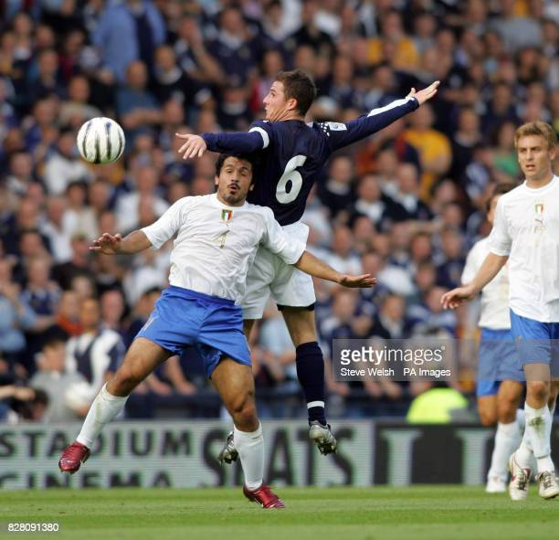 Scotland's Barry Ferguson outjumps Italy's Gennaro Gattuso during the World Cup qualifier at Hampden Park Glasgow Saturday September 3 2005 PRESS...