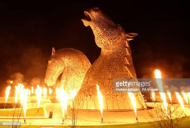 Scotland's biggest art installation has been lit up as part of a spectacular launch event Artist Andy Scott's 300tonne 30m high Kelpie horse heads...