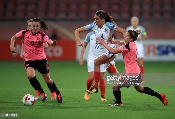 Scotland's Caroline Weir and Joanne Love battle for the ball with England's Jill Scott during the UEFA Women's Euro 2017 Group D match at Stadion...