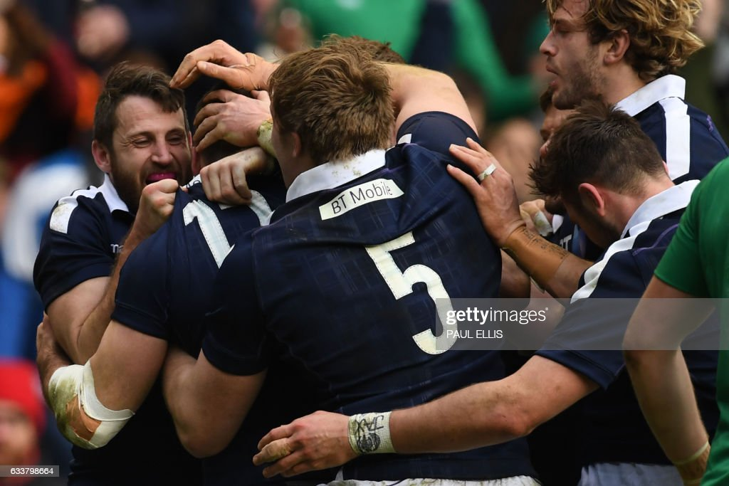 Scotland's center Alex Dunbar celebrates with teammates after scoring their third try during the Six Nations international rugby union match between Scotland and Ireland at Murrayfield in Edinburgh, Scotland on February 4, 2017. / AFP / Paul ELLIS