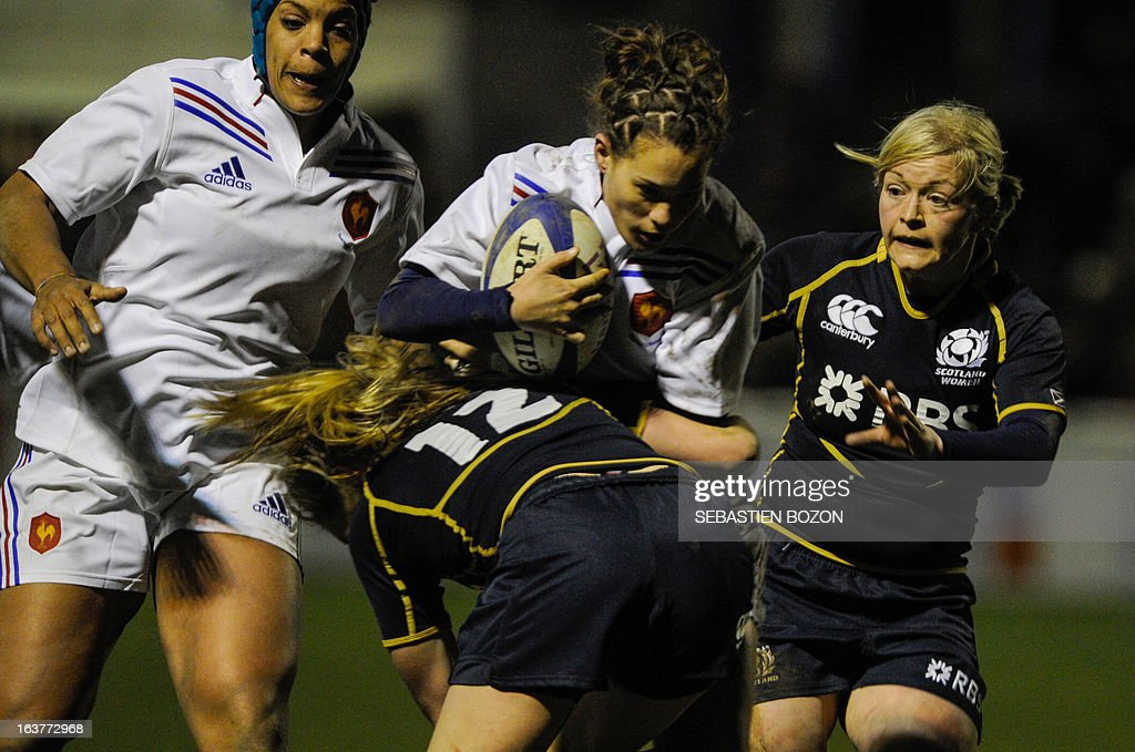 Scotland's center Annabel Sergeant (2nd L) tackles France's center Lucille Godiveau during the Six Nations women's international rugby union match between France and Scotland at the Bourillot Stadium in Longvic, eastern France, on March 15, 2013.