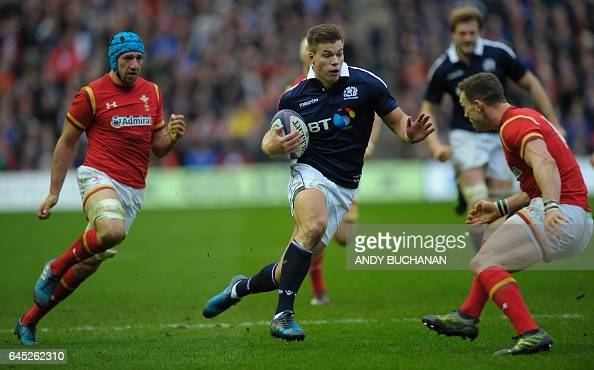 Scotland's center Huw Jones vie with Wales' flanker Justin Tipuric and Wales' wing George North during the Six Nations international rugby union...