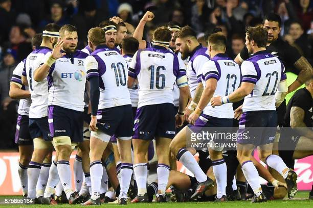 Scotland's centre Huw Jones celebrates with tammates scoring their frst try during the international rugby union test match between Scotland and New...
