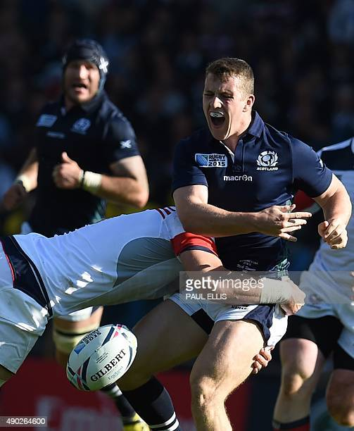 Scotland's centre Mark Bennett is tackled by US flanker Al McFarland during a Pool B match of the 2015 Rugby World Cup between Scotland and USA at...