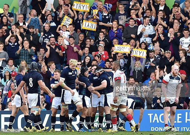 Scotland's centre Matt Scott celebrates with teammates after scoring their fourth try during a Pool B match of the 2015 Rugby World Cup between...