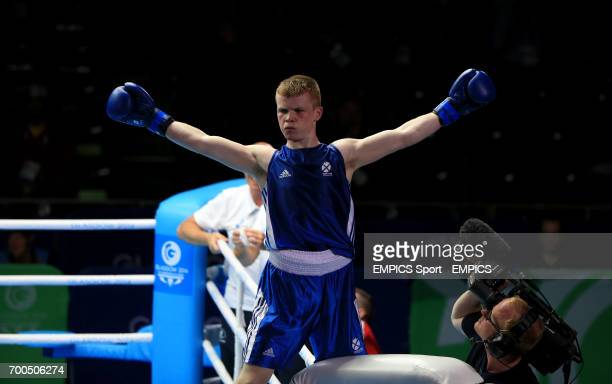 Scotland's Charlie Flynn celebrates his win against Wales' Joseph Cordina in the Men's Light Semifinal 1 at the SECC during the 2014 Commonwealth...