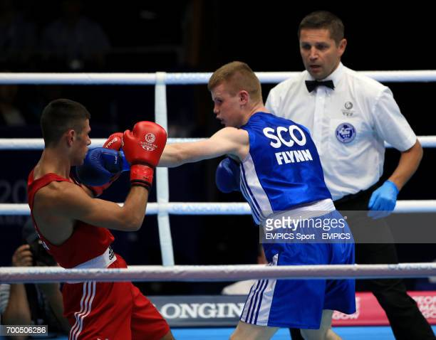 Scotland's Charlie Flynn in action against Wales' Joseph Cordina in the Men's Light Semifinal 1 at the SECC during the 2014 Commonwealth Games in...