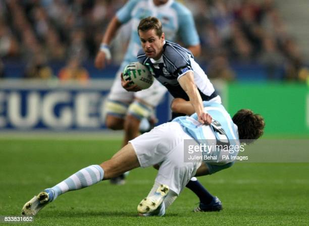 Scotland's Chris Paeterson is tackled by Argentina's Juan Hernandez