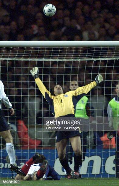 Scotland's Christian Dailly tries for a goal but England's keeper David Seaman saves the ball during the 2000 European Championships qualifying...