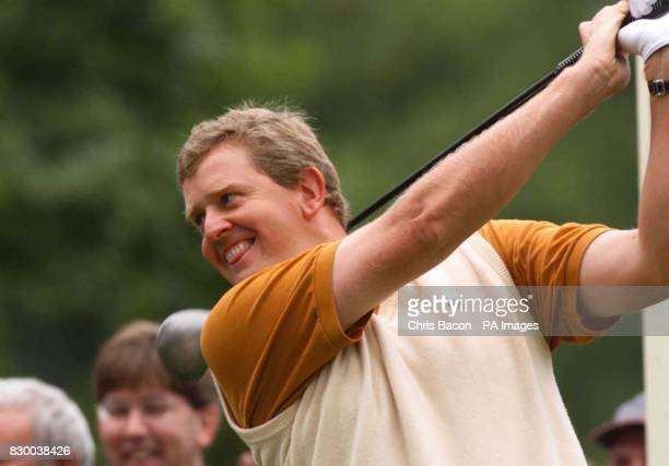 Scotland's Colin Montgomerie jokes with the crowds before teeing off on the first today at the start of the third round of the Standard Life Loch...