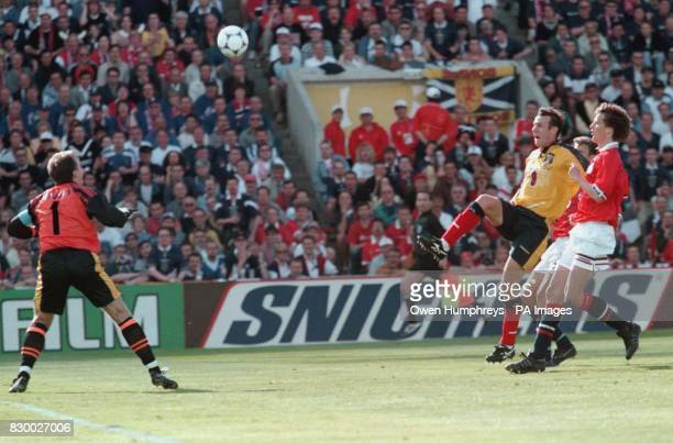 Scotland's Craig Burley scores Scotland's equaliser against Norway and keeper Frode Grodas is stranded in Bordeaux today Picture by Owen Humphreys