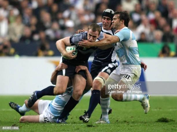 Scotland's Dan Parks is tackled by Argentina's Juan Hernandez during the IRB Rugby World Cup Quarter Final match at Stade de France St Denis France