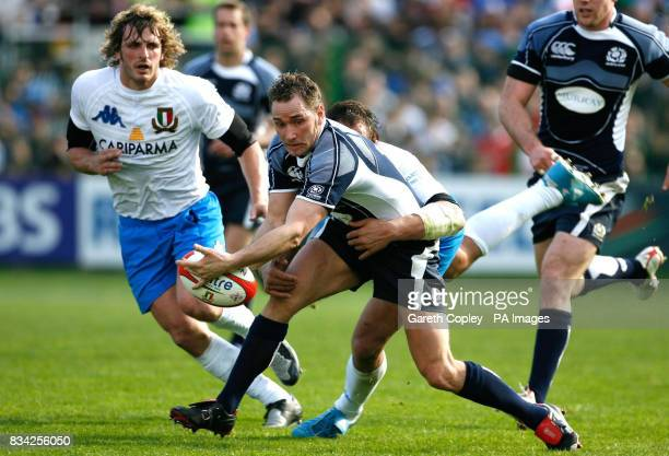 Scotland's Dan Parks loses the ball under pressure from Italy's Sergio Parisse during the RBS 6 Nations match at the Stadio Flaminio Rome Italy