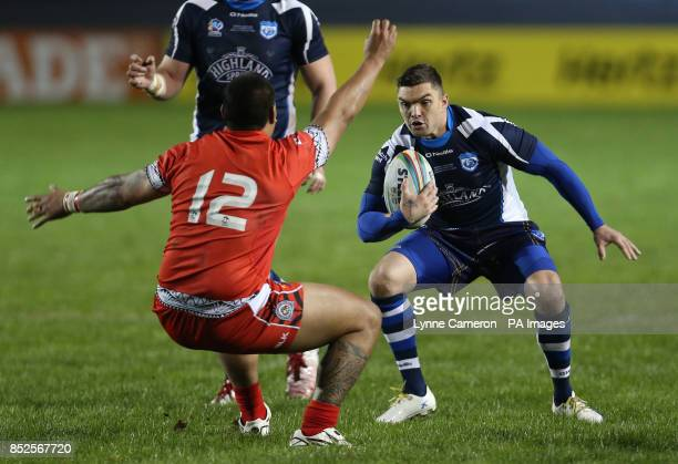 Scotland's Danny Brough and Tonga's Sika Manu during the 2013 World Cup match at Derwent Park Workington PRESS ASSOCIATION Photo Picture date Tuesday...