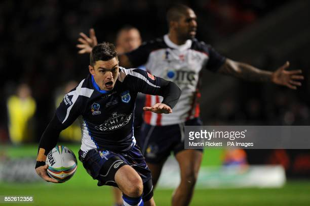 Scotland's Danny Brough drives for the line during the match with USA during the the 2013 World Cup match at Salford City Stadium Salford