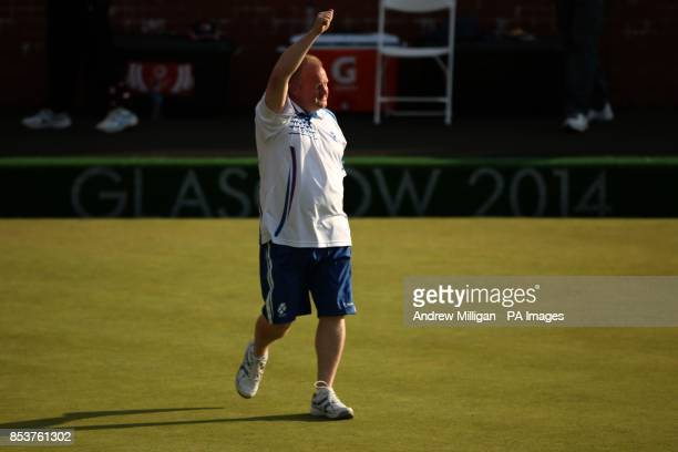 Scotland's Darren Burnett celebrates after winning the Men's Singles bowls final against Canada's Ryan Bester at Kelvingrove Lawn Bowls Centre during...