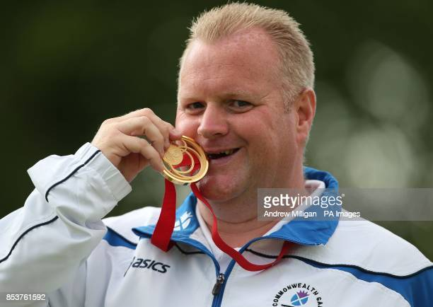 Scotland's Darren Burnett kisses his gold medal after winning the Men's Singles bowls final against Canada's Ryan Bester at Kelvingrove Lawn Bowls...