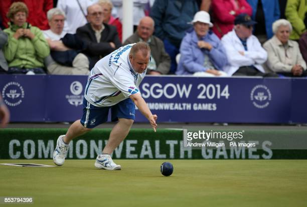 Scotland's Darren Burnett plays a bowl during his Mens Singles quarterfinal match against Northern Ireland's Martin McHugh at Kelvingrove Lawn Bowls...