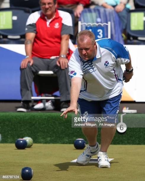 Scotland's Darren Burnett throws a bowl against Australia's Aron Sherriff in the Men's Single Semifinals at Kelvingrove Lawn Bowls Centre during the...