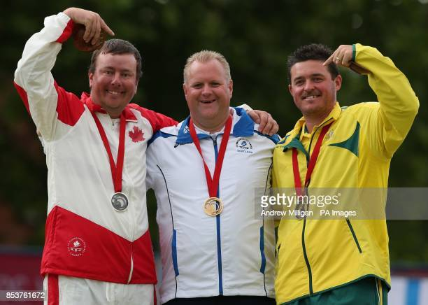 Scotland's Darren Burnett with his gold medal after winning the Men's Singles bowls final against Canada's Ryan Bester and Bronze medalist...