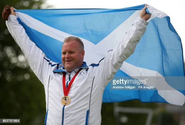 Scotland's Darren Burnett with his gold medal after winning the Men's Singles bowls final against Canada's Ryan Bester at Kelvingrove Lawn Bowls...