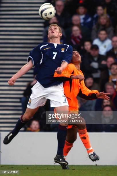 Scotland's Darren Fletcher and Holland's Giovanni van Bronckhorst battle for the ball