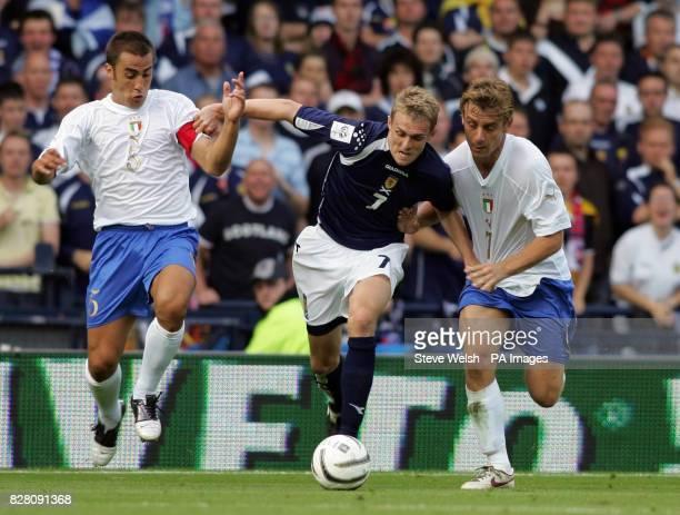Scotland's Darren Fletcher goes past Italy's Fabio Cannavaro and Daniele de Rossi during the World Cup qualifier at Hampden Park Glasgow Saturday...