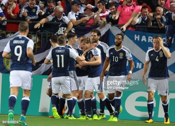Scotland's defender Stuart Armstrong celebrates scoring the 10 goal with his teammates during the FIFA World Cup 2018 qualification football match...