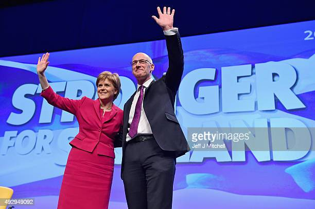 Scotland's Deputy First Minister John Swinney is applauded by First Minister Nicola Sturgeon following his speech during the afternoon session on day...