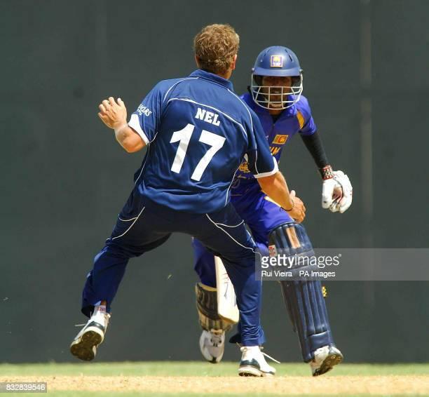 Scotland's Dewald Nel and Sri Lanka's Upal Tharanga during a warm up match at the Three Ws Oval Bridgetown Barbados