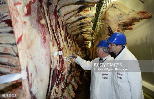 Scotland's Enviroment and Rural Development Minister Ross Finnie MSP with interim chairman of Quality Meat Scotland Donald Biggar view beef being...