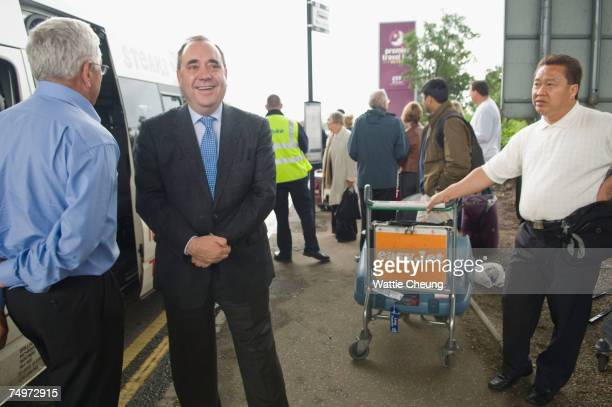 JULY 1 Scotland's First Minister Alex Salmond speaks to a passenger at Glasgow Airport July 1 2007 in Glasgow Scotland Salmond spoke to the emergency...