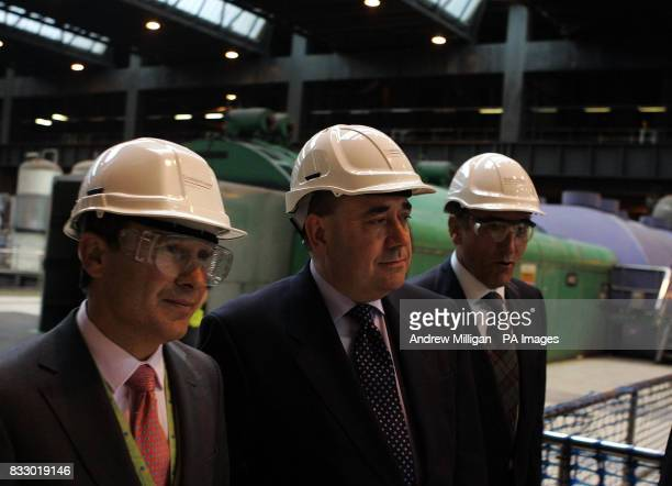 Scotland's First Minister Alex Salmond with Jose Luis Del Valle chief executive of Scottish Power and Ignacio Galan chief executive and Chairman of...