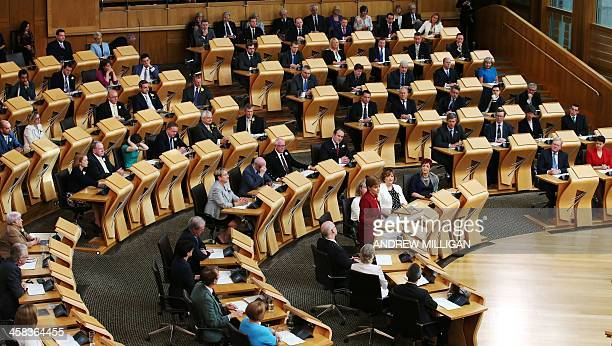 Scotland's First Minister and Leader of the Scottish National Party Nicola Sturgeon speaks during the opening of the fifth session of the Scottish...