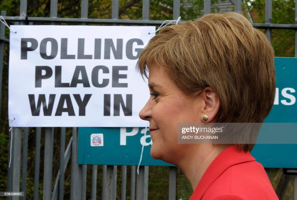 Scotland's First Minister and Leader of the Scottish National Party (SNP), Nicola Sturgeon, arrives to cast her vote in Glasgow, on May 5, 2016. While London chooses a new mayor, there are also elections to the Scottish, Welsh and Northern Irish assemblies, and 124 local authorities scattered across England. / AFP / Andy Buchanan