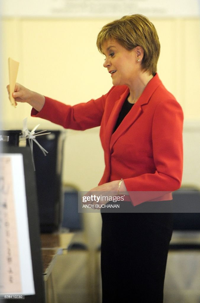 Scotland's First Minister and Leader of the Scottish National Party (SNP), Nicola Sturgeon casts her ballot paper inside a Polling Station at Broomhouse Community Hall in east Glasgow, on May 5, 2016. With London choosing a new mayor today, there are also elections to the Scottish, Welsh and Northern Irish assemblies, and 124 local authorities scattered across England. / AFP / Andy Buchanan
